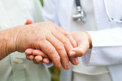 Doctor holding trembling hand Stock Images