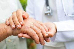 Doctor holding trembling hand Royalty Free Stock Photography