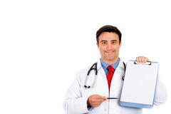 Doctor holding up clipboard Stock Image