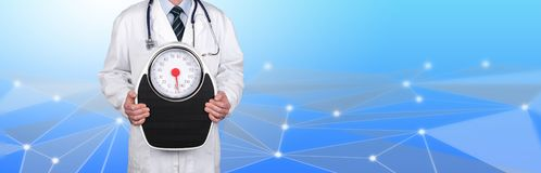 Doctor holding a weight scale. On abstract background royalty free stock photography