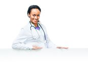 Doctor holding a white blank board Stock Photo