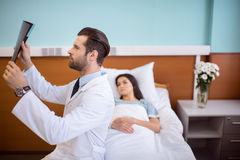 Doctor holding x-ray image Stock Photos