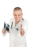 Doctor holding X-rays and keeps the thumb up Royalty Free Stock Image