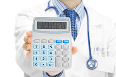 Doctor holdling in his hand calculator Stock Photos