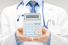Doctor holdling in his hand calculator - studio shoot Royalty Free Stock Photos