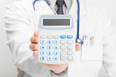 Doctor holdling in his hand calculator - studio shoot Stock Photography