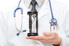 Doctor holdling in his hand a hourglass Royalty Free Stock Images