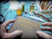Doctor Holds Book of HIV / AIDS sarcoma kaposi In A Hospital royalty free stock photos