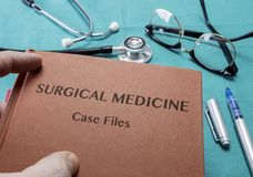 Doctor Holds Book On Surgical Medicine In A Hospital Stock Images