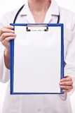 Doctor holds clipboard with empty sheet. Stock Photography