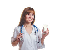 The doctor holds a glass with water in hand and smiles Stock Images