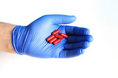 The doctor holds in his hand medicines, pills royalty free stock photos