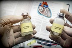 Doctor holds two vials of idarubicina and Oncaspar to inject, medicine used in acute lymphatic leukemia disease Royalty Free Stock Photography