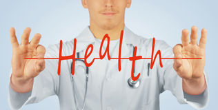 Doctor holds the word health Stock Photography
