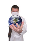 Doctor holds world globe featuring America Royalty Free Stock Images