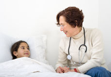 Doctor home visit Stock Image