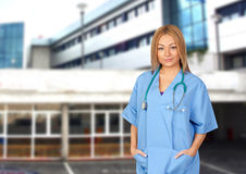 Doctor with the hospital of background Royalty Free Stock Images