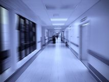 Doctor in hospital corridor, zoom blurred background with two tone color style. Doctor in hospital corridor, zoom blurred background. Two tone color style stock images