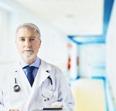 Doctor in the hospital hallway with tablet Royalty Free Stock Photos