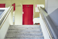 Doctor hospital stairs waiting corridor Lift red. Corridor with doctor waiting on a staircase and front lift red in hospital Stock Image