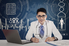 Doctor in hospital with virtual screen Stock Photos