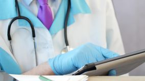 Doctor at hospital working on a digital tablet