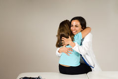 Doctor Hugs Girl- Horizontal Stock Photography