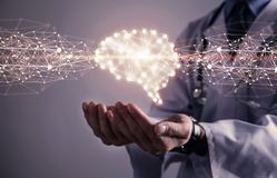Doctor with human brain. Medical technology concept royalty free stock image