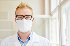 Doctor with hygenic surgical mask Stock Photos