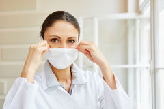 Doctor with hygienic surgical mask. At office royalty free stock photo