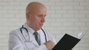 Doctor Image Preparing to Write a Medical Prescript royalty free stock photos