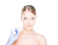 Doctor injecting botox into face of a young woman Stock Photo
