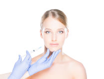 Doctor injecting botox into face of a young woman Royalty Free Stock Photo