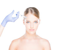 Doctor injecting botox into a woman's face Royalty Free Stock Photos