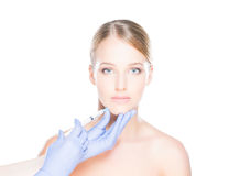 Doctor injecting botox into a woman's face Royalty Free Stock Photo