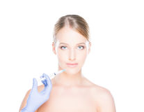 Doctor injecting botox into a woman's face Stock Photography