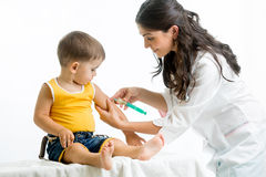 Doctor injecting child. Boy isolated royalty free stock images