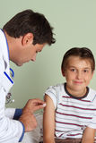 Doctor injecting child vaccine Stock Photography