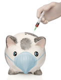 Doctor injecting an infected piggy bank Royalty Free Stock Photo