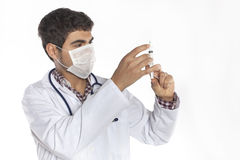 Doctor with an injection Royalty Free Stock Images