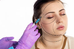 Doctor injects a botox Stock Images