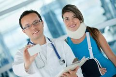 Doctor with an injured woman Royalty Free Stock Photos