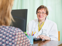 Doctor inserting information about patient Stock Image