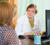 Doctor inserting information about patient Royalty Free Stock Photos