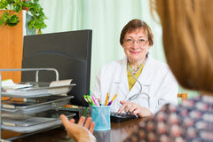 Doctor inserting information about patient Royalty Free Stock Images