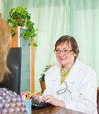 Doctor inserting information about patient Stock Photography