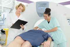 Doctor inspecting patients record Royalty Free Stock Photos