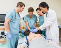 Doctor Instructing Nurses In Hospital Room Royalty Free Stock Images