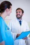 Doctor interacting with nurse Stock Photos