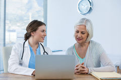 Doctor interacting with patient. In clinic Stock Photography